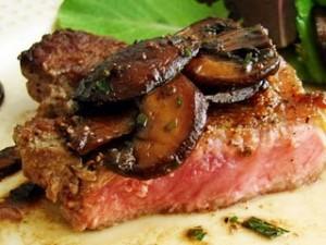 New York Strip Steak with Warm Caramelized Mushroom Salad